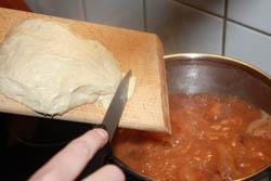 Dumpling into Hungarian bean soup